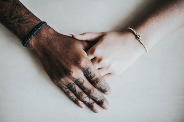 adults touching hands