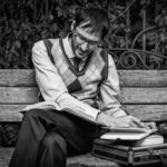 man on bench reading books every husband should read