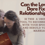 couple holding the Love Dare book