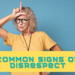 Woman making a loser sign on her forehead. Caption reads common signs of disrespect
