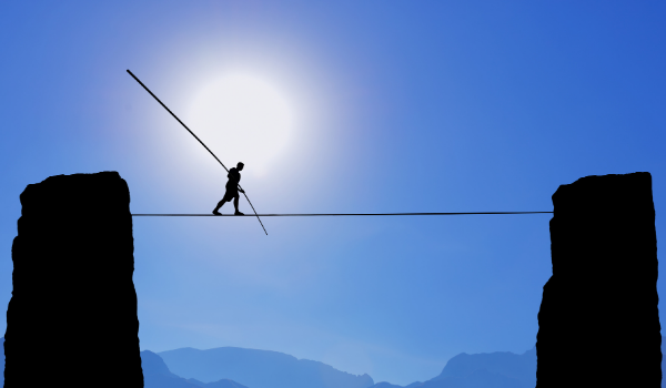 Man walking on a tightrope